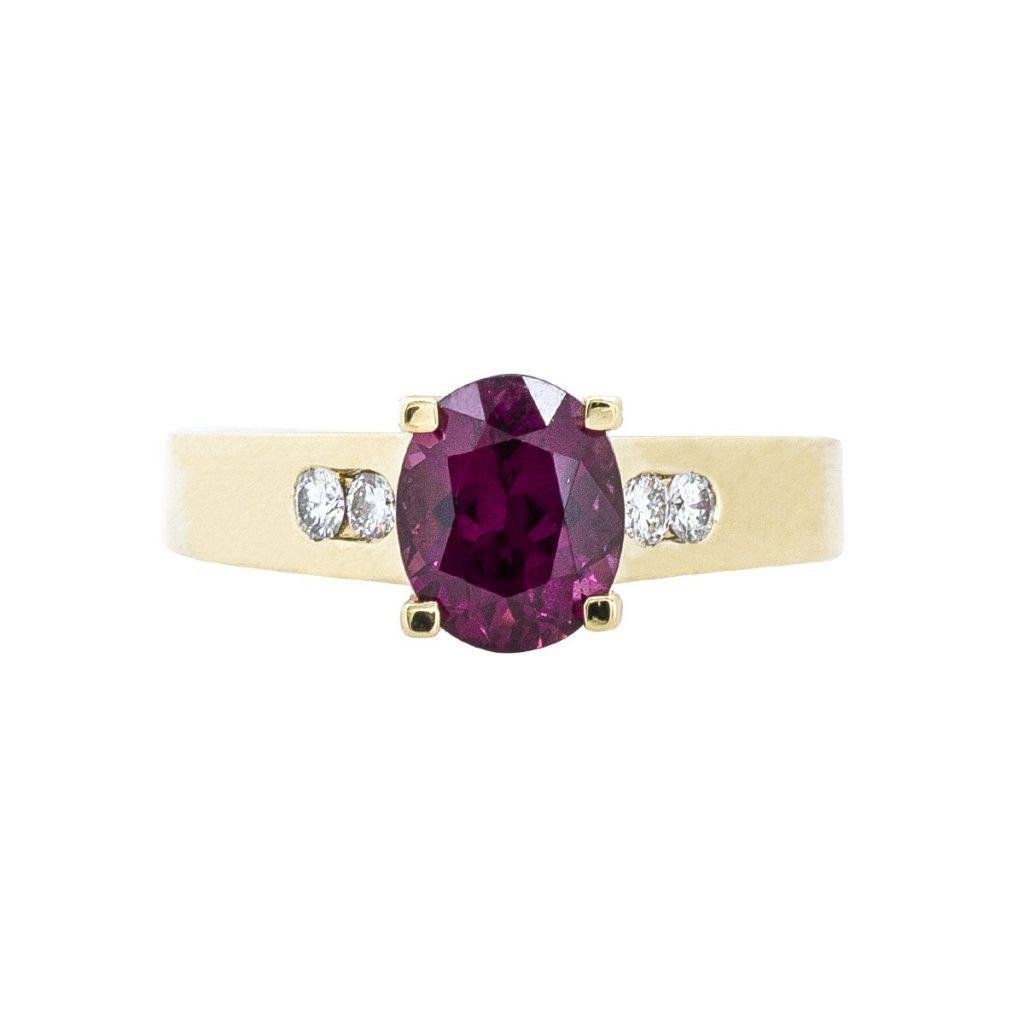 Garnet colored gemstone ring