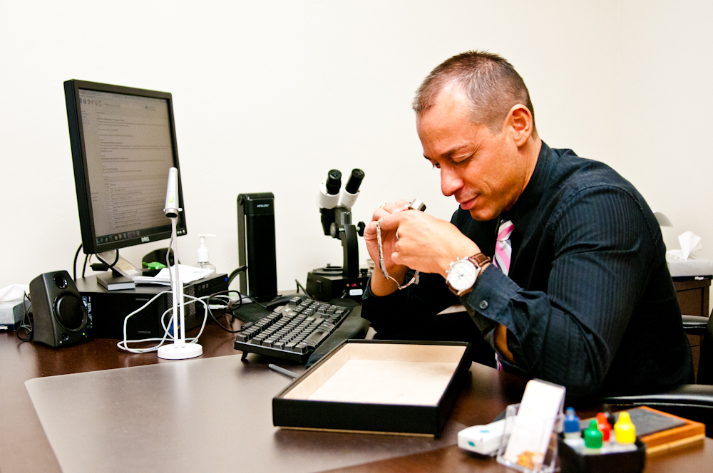 picture of jewelry buyer evaluating a watch