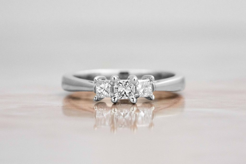 dainty three stone ring