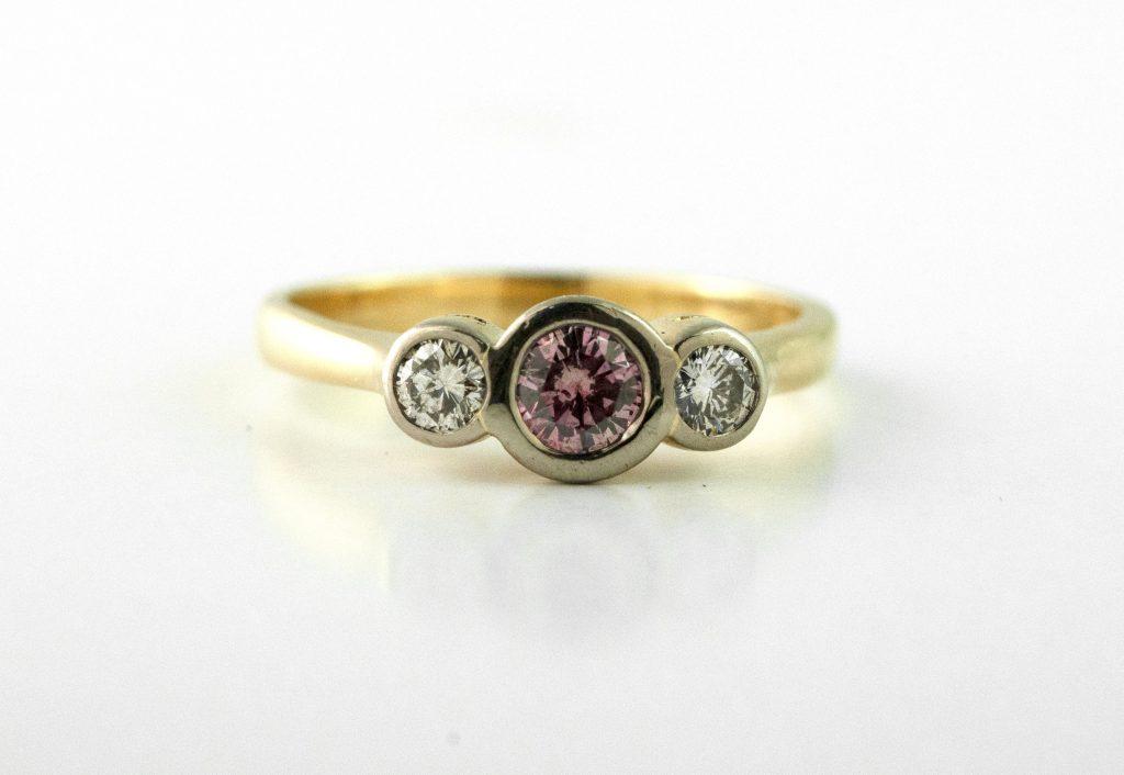 Gold bezel minimalist engagement ring