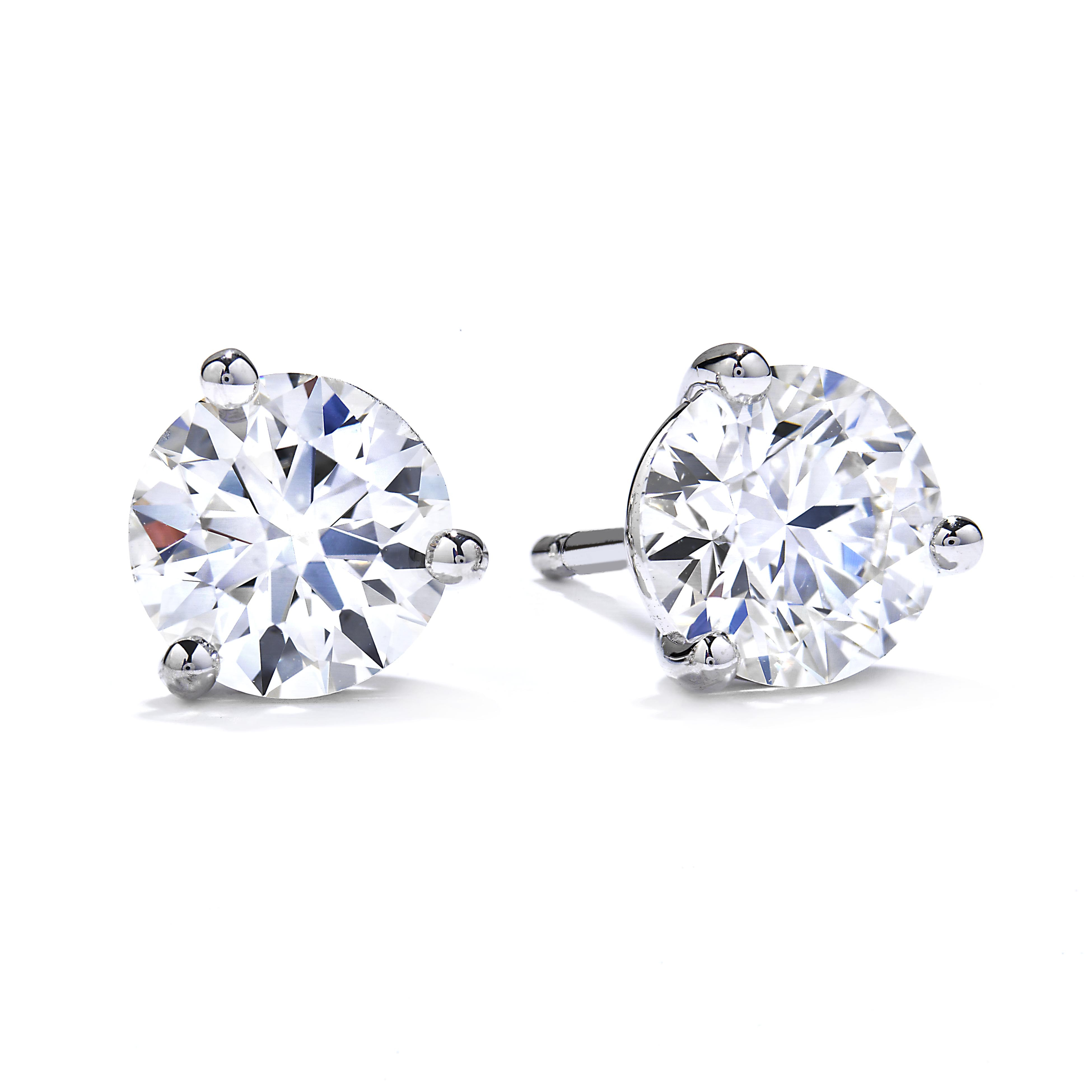 New Hearts On Fire® 0.25 CTW Diamond Three Prong Stud Earrings